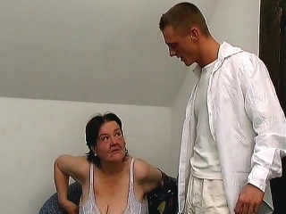 Tanya has been noticing her young neighbor's huge bulge. So when he comes over for a snack one afternoon, Tanya seduces him by showing off her massive melons and kneeling over to massage his balls and suck him off.