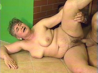 This old plumper named Patricia has a soft spot for younger guys. When this suave looking stud came knocking at her door, she wasted no time and took him to her garage to examine his package and gets her wrinkled mug jizzed.