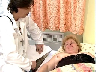 Horny Leila is very proud of her big, pink nipped tits. This blonde plumper is such a show off that she eagerly lets her gorgeous doctor examine her huge tits and play with her erect nips. Of course, she pays him well by sucking his huge cock off.